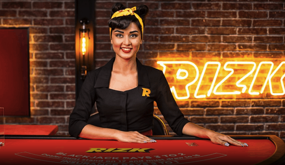 A live dealer at Rizk's branded blackjack table