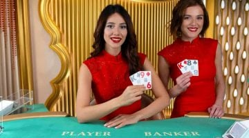 Two brunette live baccarat dealers