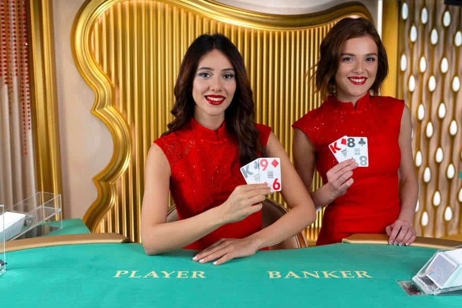 Brunette baccarat dealers at green table