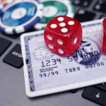 credit card play chips and dice on a laptop image