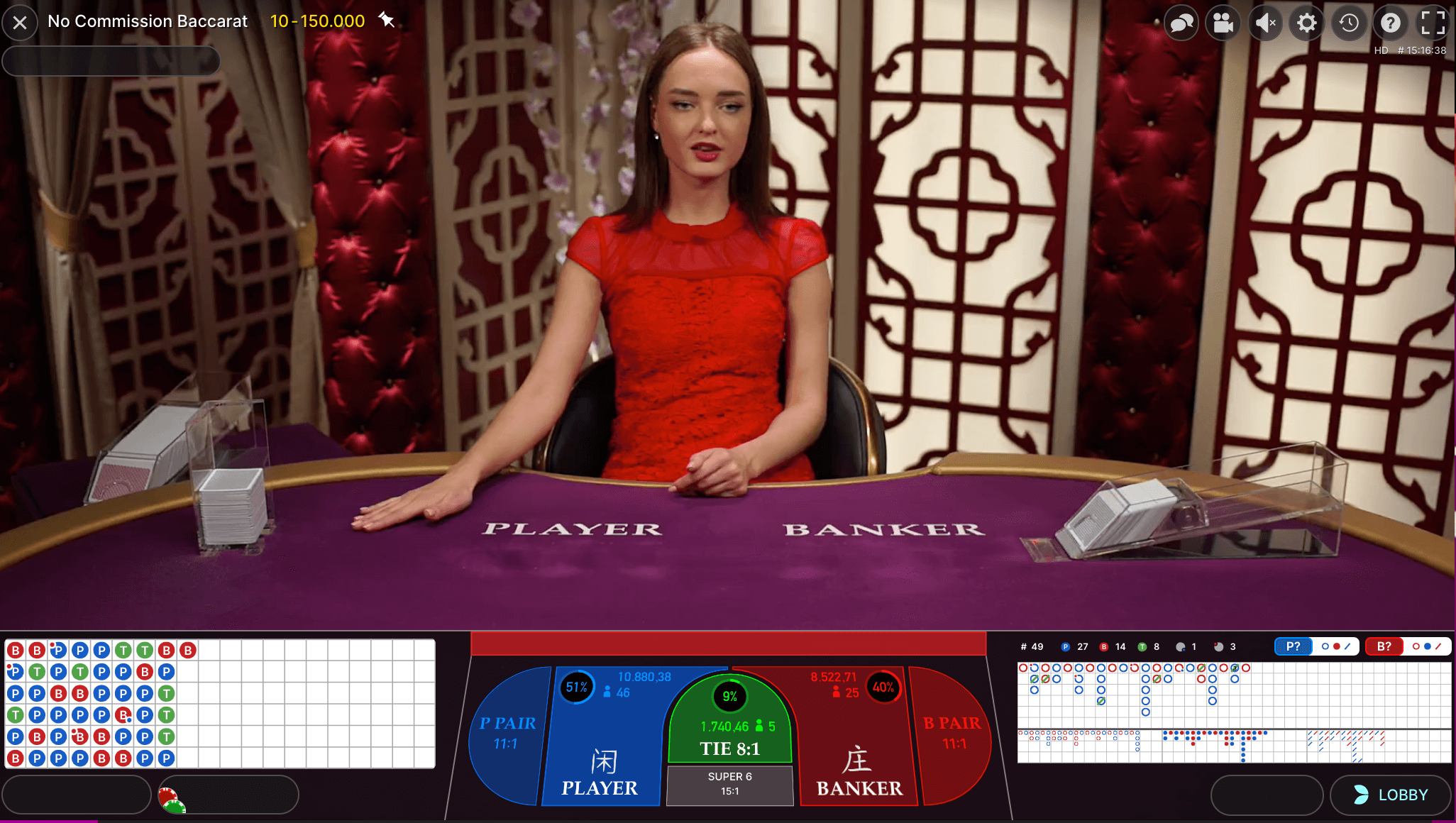 live dealer at baccarat table with road interface