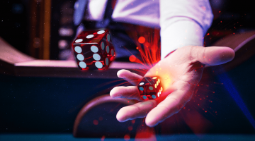 image showing a dealer throwing two craps dice in the air