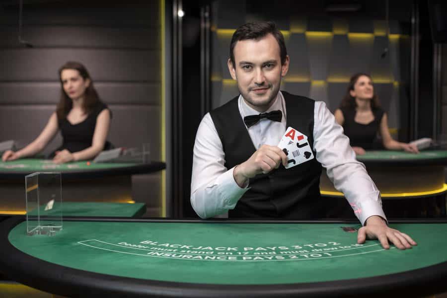 photo of a blackjack dealer holding two cards
