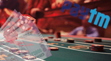 image of a roulette table, rupees, and paytm logo