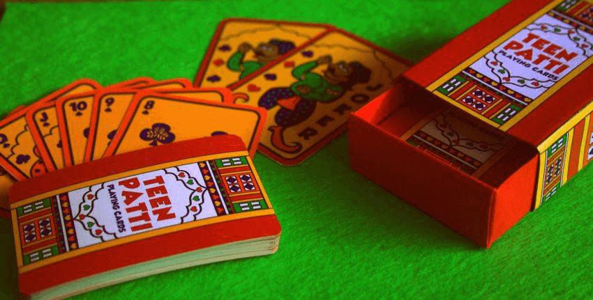 teen patti card deck on green felt