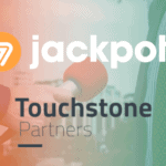 hand holding microphone. sevenjackpots and touchstone partners logos